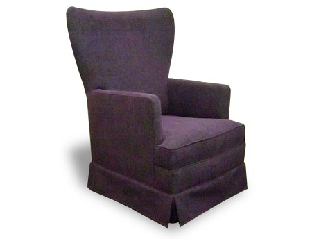 Angela high backed armchair. Dark upholstery with no visible feet. Valance