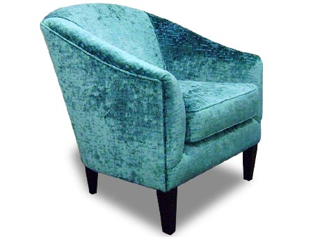 Bristol Armchair Upholstered with wooden legs. Arms slope steeply down from the high back.