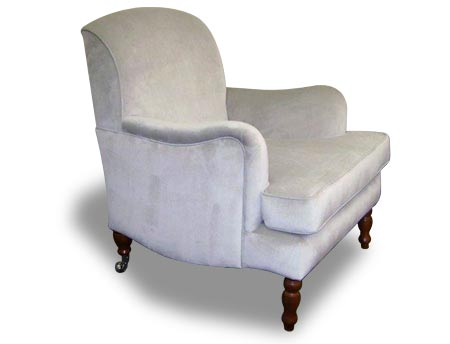 Kate chair. Armchair with ornate turned wooden legs and curved arms.