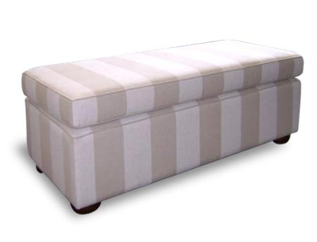 rectangular ottoman with striped fabric upholstery.