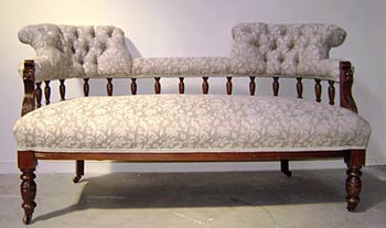 ornate sofa with turned wooden legs and back reupholstered by the skilled upholstery company Wilson and Nicholson